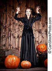 scary witch - Portrait of a beautiful witch lady in black...
