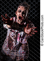 Scary zombie cosplay - Creepy zombie in handcuffs