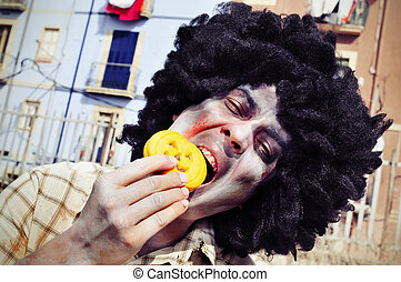 scary zombie eating a pumpkin-shaped cookie