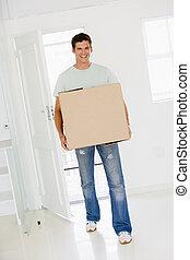 scatola, spostamento, casa nuova, uomo sorridente