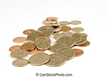 Horizontal shot of a large group of scattered coins on a white background.