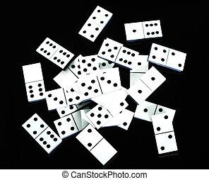 Scattered dominoes - Dominoes scattered on black background