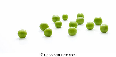 Scattered green peas closeup