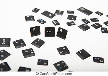 Scattered loose key covers from a laptop computer