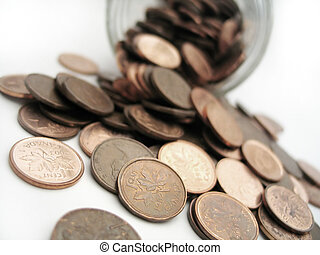 Scattered Pennies - Pennies spilling out of a glass jar. ...