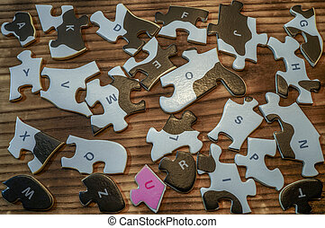 Scattered puzzles on a wooden table