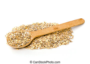 rolled oats - scattered rolled oats with wooden spoon