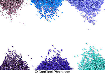 A scattering of multicolored beads on a white isolated background