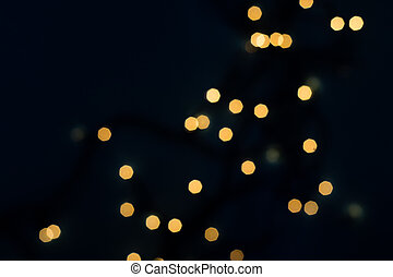 scattering of hexagonal gold bokeh on black background