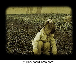 little girl find the stones at autumnal beach stylized at old movie