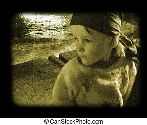 portrait of child at autumnal sea beach stylized at old movie