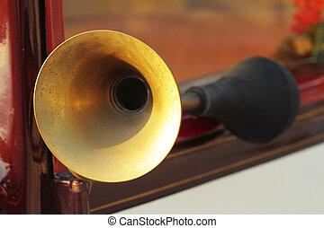 scene detail of antique car horn