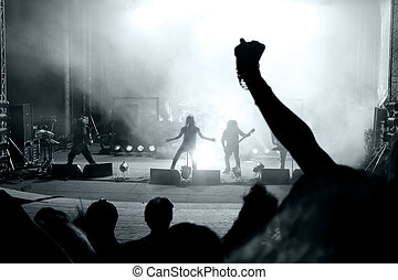 Scene from a rock concert with silhouette singer