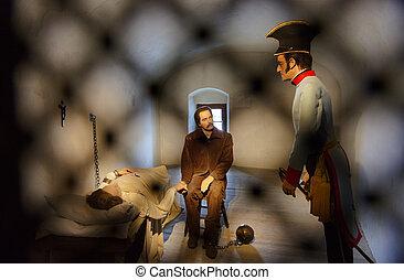 Scene in castle Kufstein (Austria) - prisoners and soldier