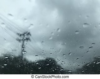 scene of countryside from car windscreen when hardly raining
