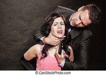 Scene of violence with firearm between men and women....