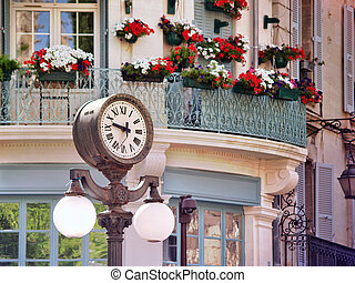 clock in Old center of Avignon, France - Scene with a...