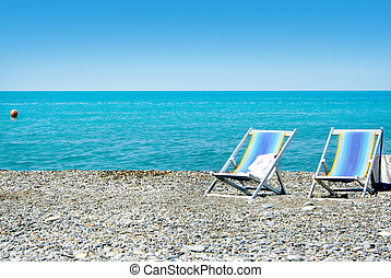 chaise longue on sea beach