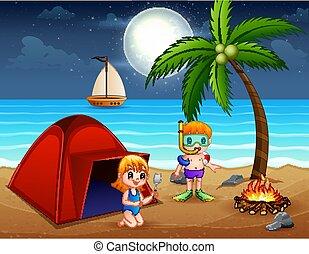 Scene with children having fun on the beach at night