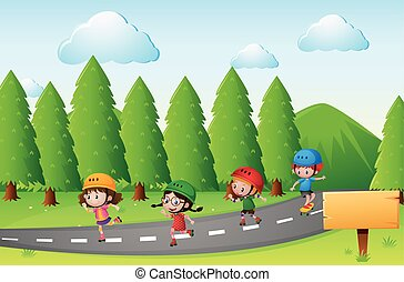 Scene with kids skating on the road
