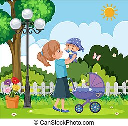 Scene with mother and little baby in the park
