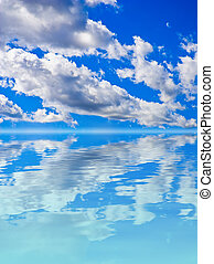 Scenery background - clouds in blue sky reflection in water