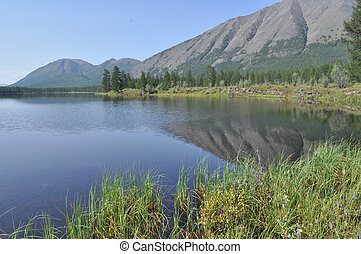 Scenery of the lake and reflections of the mountains. Russia...
