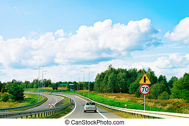 Scenery with clouds and Car on Road Maribor Slovenia