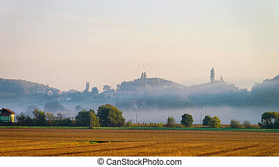 Scenery with field and fog in Slovenia
