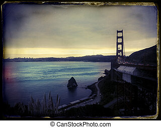 Late afternoon on a cloudy day above the San-Fransisco bay and Golden Gate bridge. Image stylized with vintage instant film aesthetics. Shot with Samsung Galaxy S3.