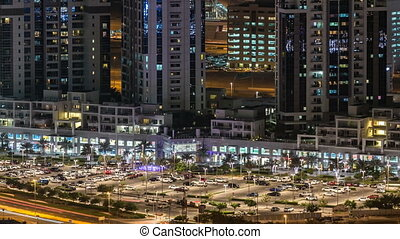 Scenic aerial view of a big modern city at night timelapse. Business bay, Dubai, United Arab Emirates.