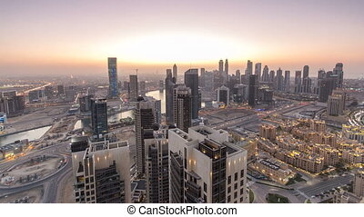 Scenic aerial view of a big modern city day to night timelapse. Business bay, Dubai, United Arab Emirates.