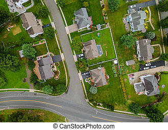 Scenic aerial view of a suburban settlement in USA with detached houses