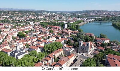 Picturesque view from drone of Givors summer cityscape on Rhone riverbanks, Auvergne-Rhone-Alpes region, France