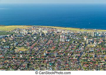 Scenic aerial view of Gelendzhik resort city district and Black sea coastline. Sunny day.