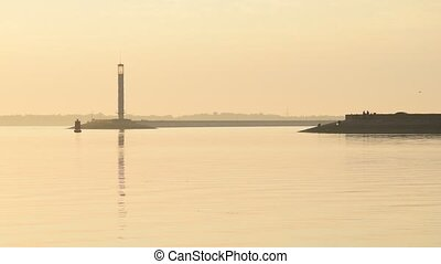 Scenic calm landscape with lighthouse at dawn