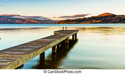 Scenic Dock on Mountain Lake at Sunrise