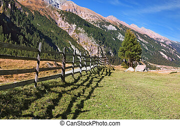 Scenic fields blocked bythe wooden fence