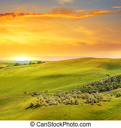 scenic fields, hills and sunrise