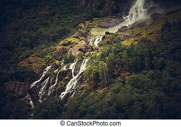 Scenic Glacial Waterfall. Pure Norwegian Landscape Scenery.