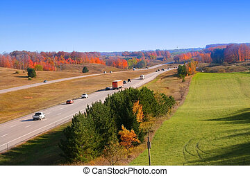 Scenic High way - Vehicles passing through scenic high way ...