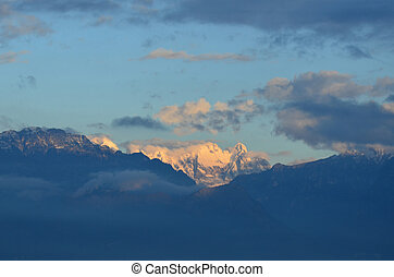 Scenic ladscape of northern Italy of the Snow capped Alps