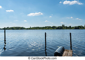 scenic landscape at Havel river in Berlin under blue summer sky