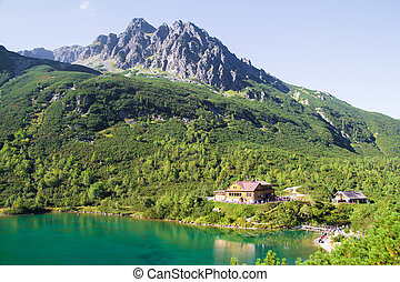 Scenic landscape with lake view of a hut in the High Tatras