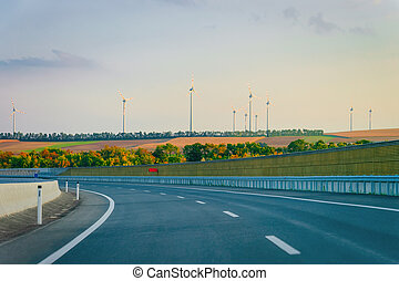 Scenic landscape with road in Slovenia wind mill