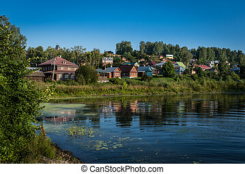 Scenic landscape with traditional buildings in Russian village