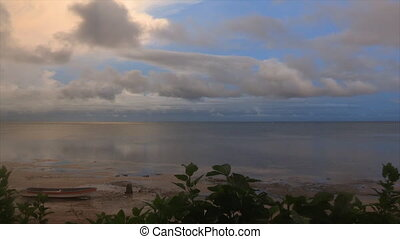 Scenic low tide beach - A scenic wide shot of a beach in low...