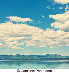 scenic mountain lake with sky and clouds. nature background.