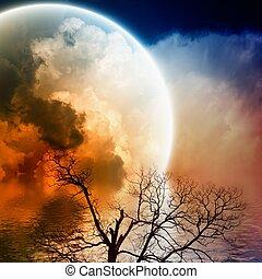 Scenic night landscape - big rainbow in dark sky with ...