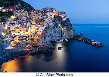 Scenic night view of colorful village Manarola in Cinque Terre,